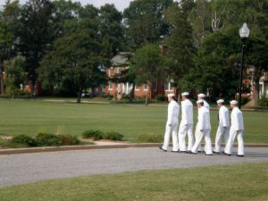 Sailors prepare to lower the flag